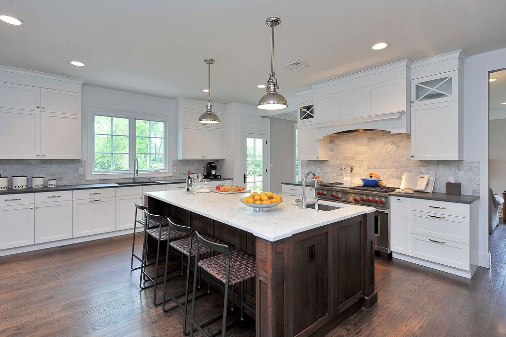 Contemporary Kitchen with Hardwood floors, European Cabinets, Soapstone counters, double oven range, French doors, Paint
