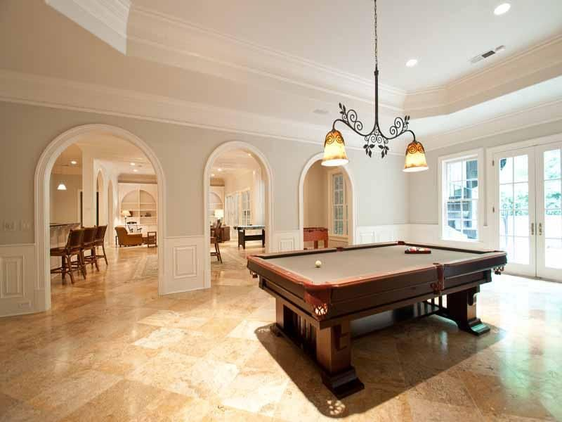 Traditional Game Room with terracotta tile floors, Pendant light, can lights, Casement, French doors, Standard height