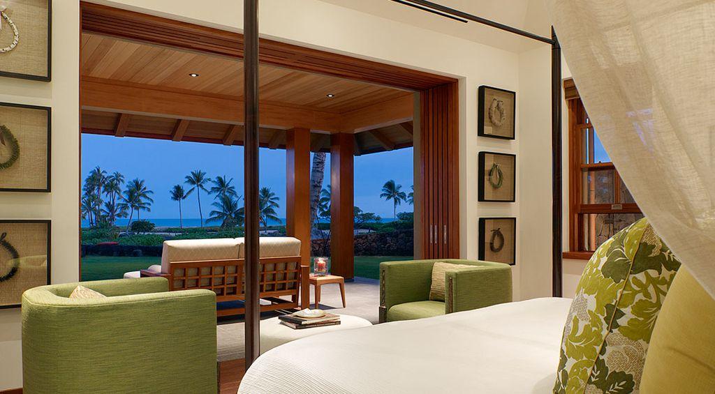 Tropical Master Bedroom with Columns, Hardwood floors, Paint 1, Standard height