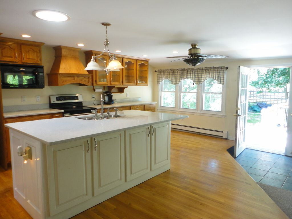 Country Kitchen With Kitchen Island Inset Cabinets In
