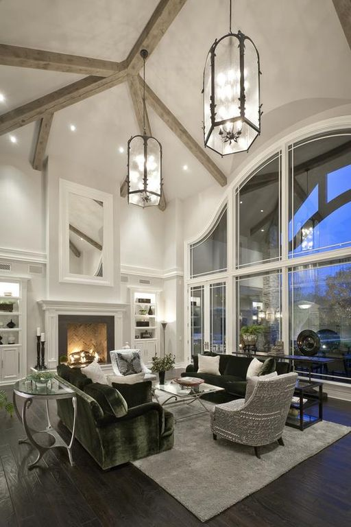 Contemporary Living Room with Paint 1, Cement fireplace, Crown molding, can lights, Cathedral ceiling, Fireplace, Chandelier
