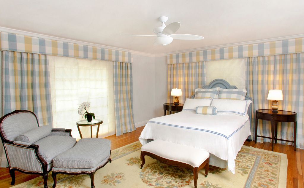Traditional Master Bedroom with Crown molding, Standard height, Hardwood floors, Ceiling fan