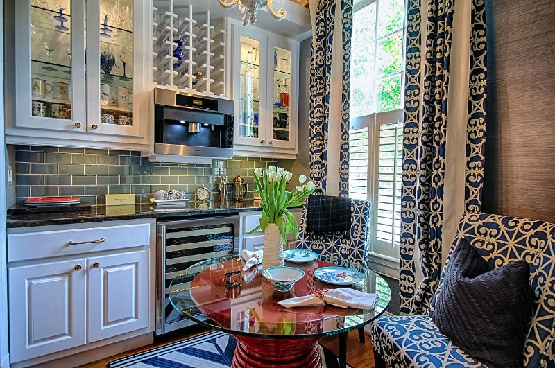 Eclectic Dining Room with can lights, Hardwood floors, picture window, High ceiling, Built-in bookshelf, Chandelier