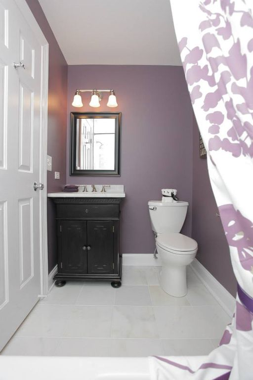 Traditional Full Bathroom with Undermount sink, six panel door, Paint 1, Corian counters, stone tile floors, drop in bathtub