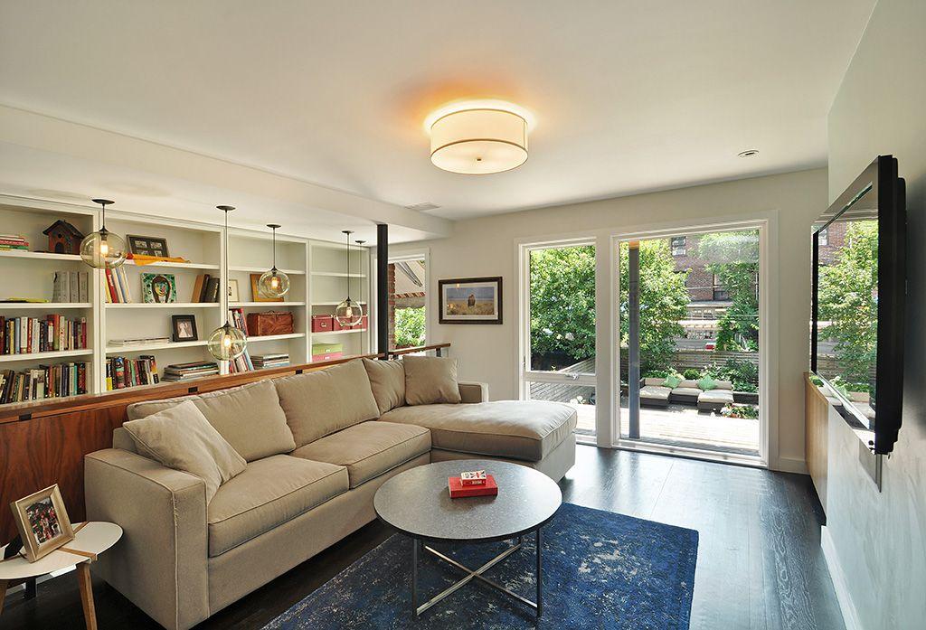 Contemporary Living Room with Pendant light, flush light, Casement, sliding glass door, Built-in bookshelf, Hardwood floors