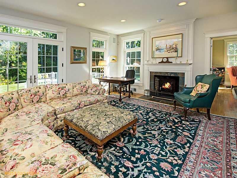 Traditional Living Room with French doors, stone fireplace, Hardwood floors, Standard height, can lights, Transom window