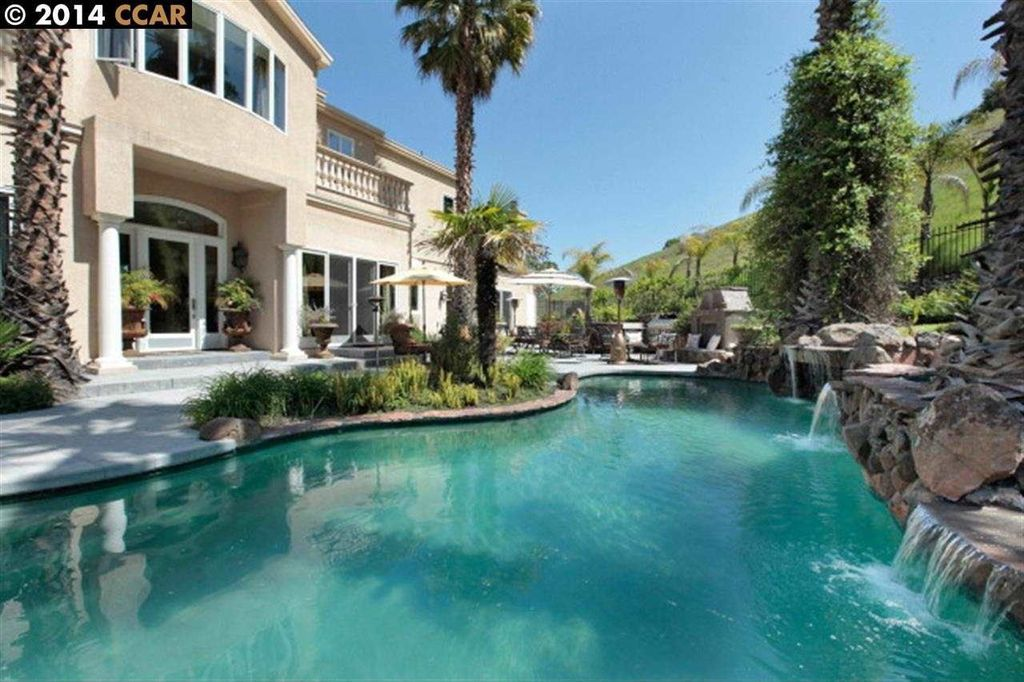 Tropical Swimming Pool with Casement, Other Pool Type, French doors, Raised beds, Fence, Deck Railing, exterior stone floors