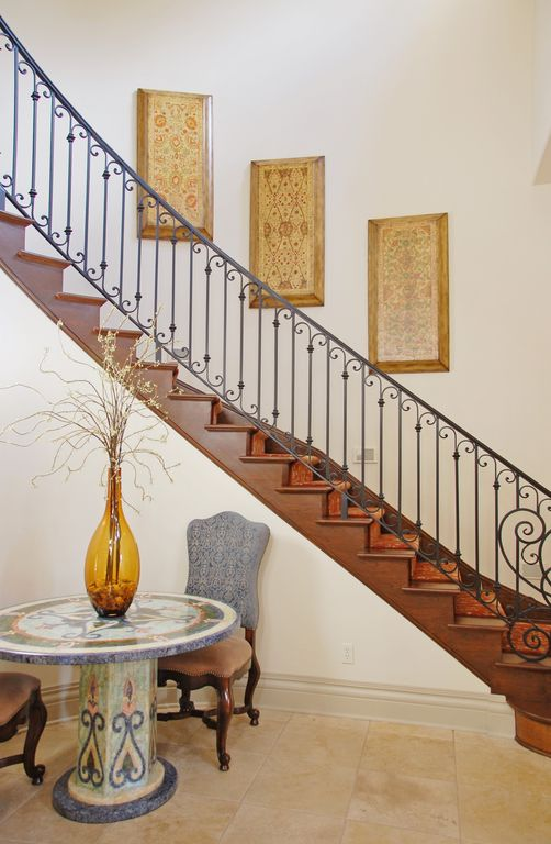 Eclectic Staircase with curved staircase, Concrete tile , Cathedral ceiling