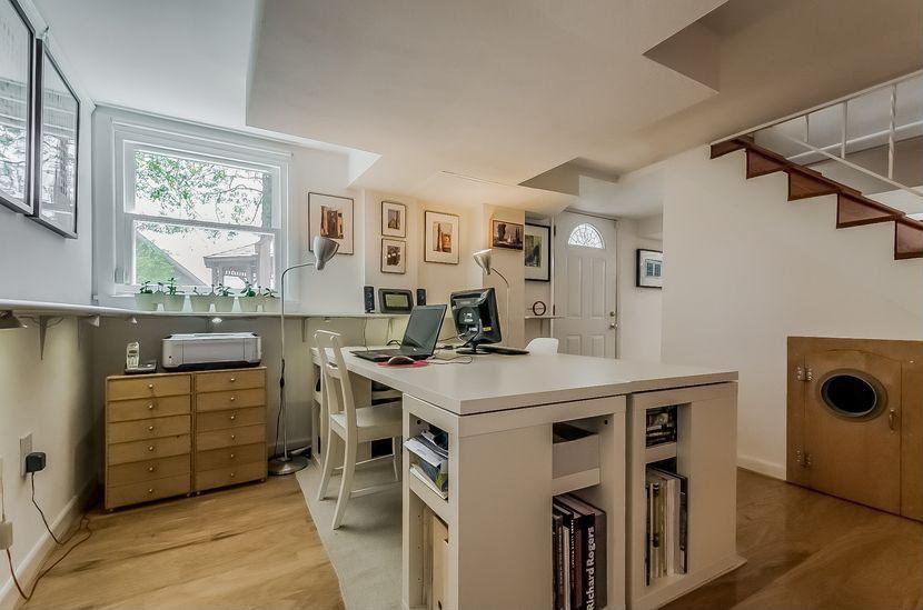Contemporary Home Office with Built-in bookshelf, Hardwood floors, Glass panel door, Standard height, double-hung window