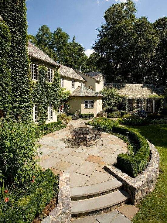 Traditional Patio with Trellis, Pathway, exterior stone floors, Outdoor kitchen, Raised beds, French doors