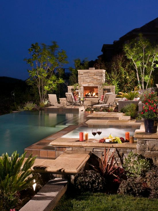 Traditional Patio with Outdoor seating, Outdoor fireplace, exterior stone floors, Infinity pool, Pathway, Pool with hot tub