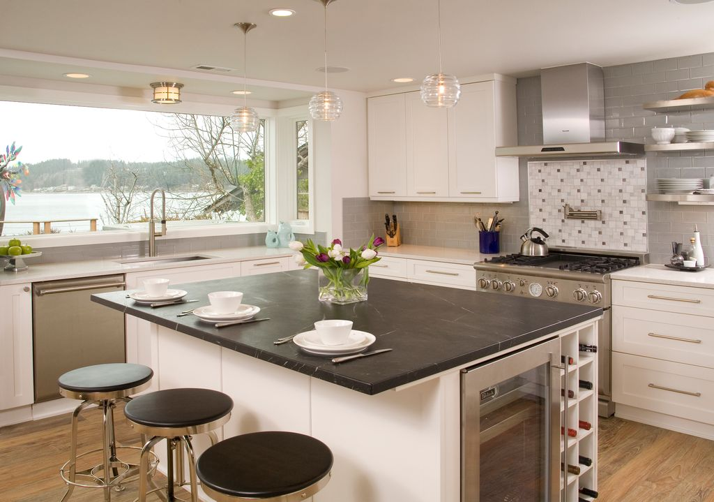 Contemporary Kitchen with Standard height, Wine refrigerator, Flat panel cabinets, can lights, picture window, gas range