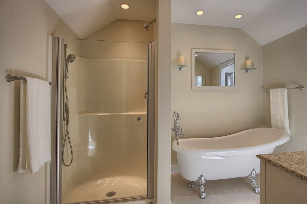 Traditional Master Bathroom with Bathtub, Standard height, Wall sconce, Master bathroom, Casement, Shower, stone tile floors