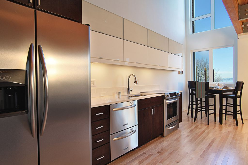 Contemporary Kitchen with Built In Refrigerator, double dishwasher, European Cabinets, Corian counters, Breakfast nook, Flush
