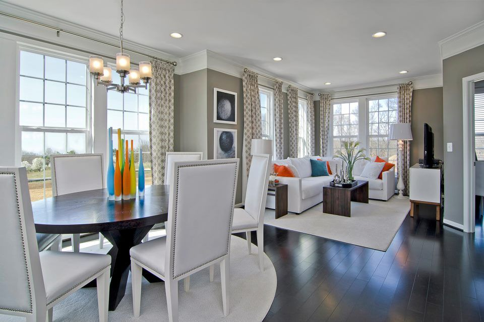 Contemporary Great Room with Crown molding, can lights, double-hung window, Hardwood floors, Chandelier, Standard height