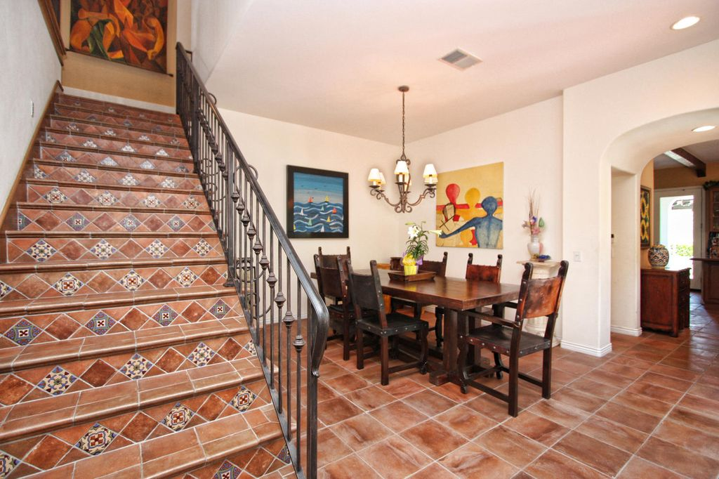 Mediterranean Staircase with Standard height, curved staircase, terracotta tile floors