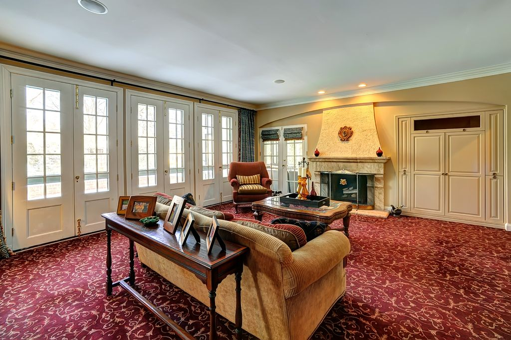 Traditional Living Room with French doors, Crown molding, can lights, Glass panel door, Standard height, Fireplace, Carpet