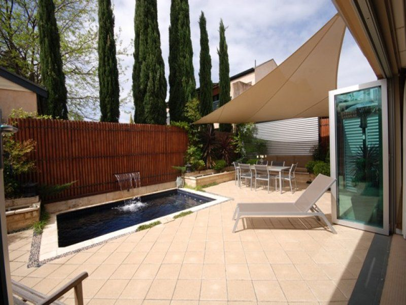 Modern Patio with exterior tile floors, exterior concrete tile floors, Fence, French doors