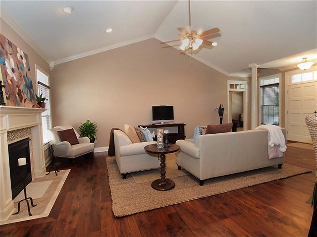 Traditional Living Room with can lights, Columns, Standard height, stone fireplace, metal fireplace, Crown molding, Fireplace