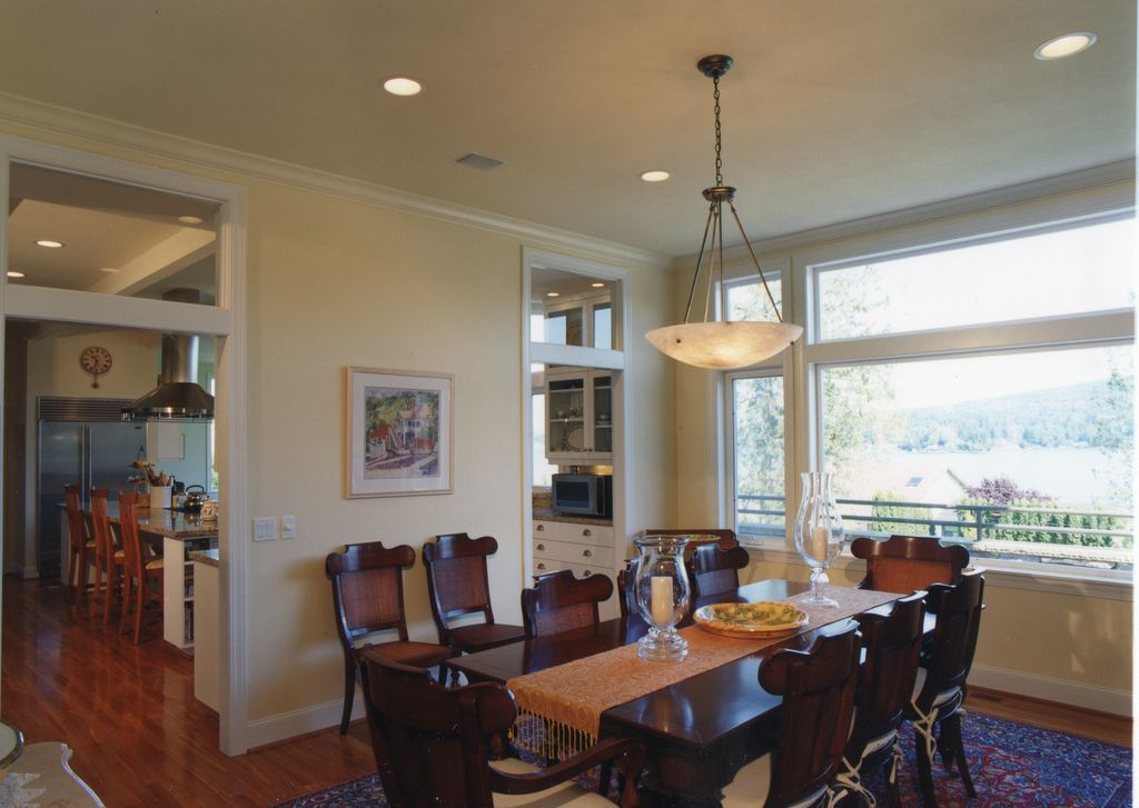Traditional Dining Room with Laminate floors, flush light, Standard height, specialty window, can lights, Crown molding