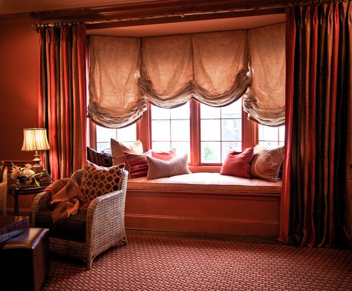Traditional Living Room with Ellese Club Chair, Uttermost 26684 Rory Table Lamp, Wainscotting, Swirled design roman curtains