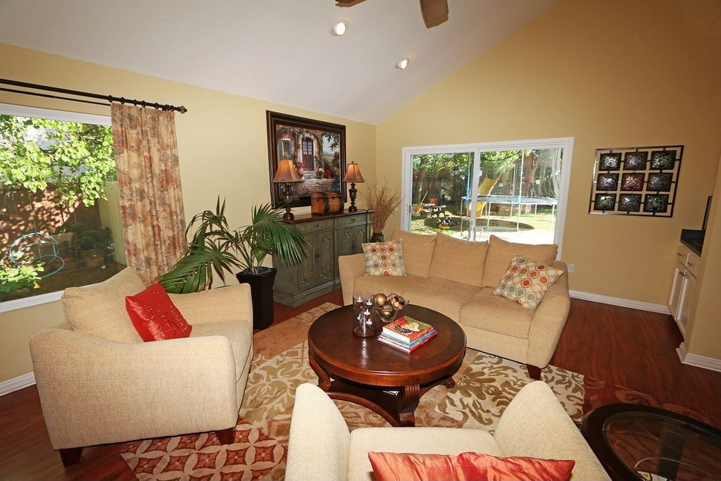 Traditional Living Room with Casement, Built-in bookshelf, can lights, picture window, Hardwood floors, Standard height
