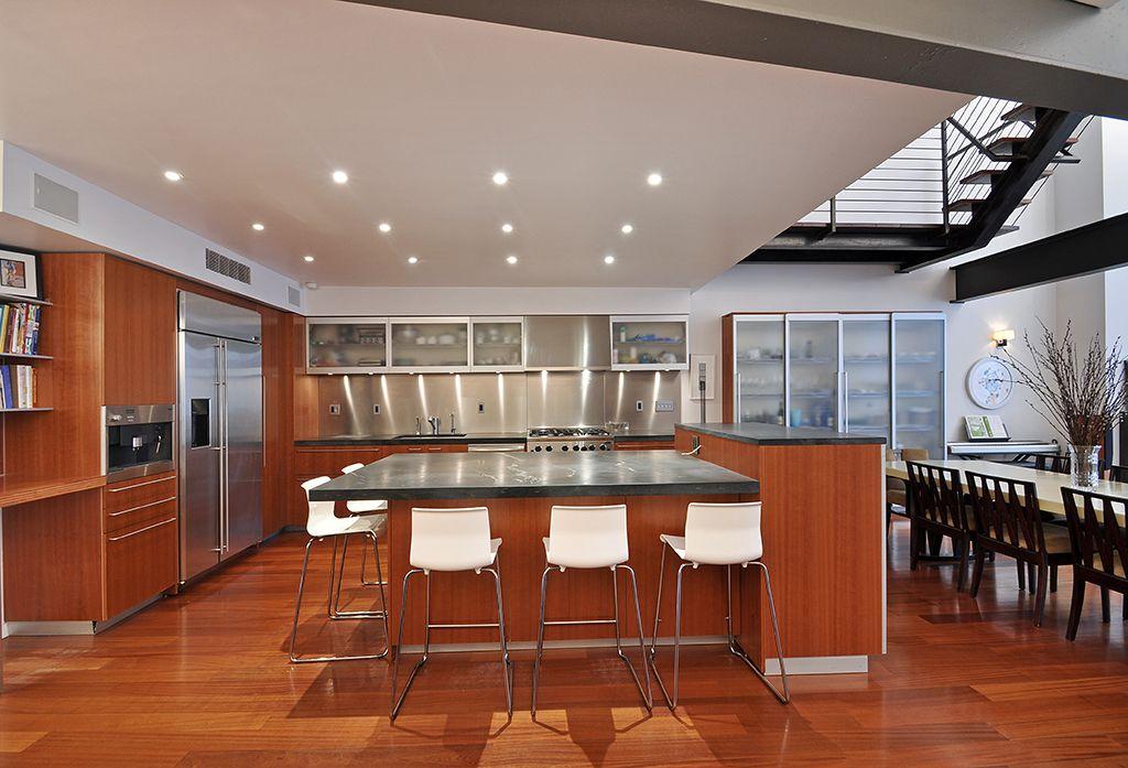 Contemporary Kitchen with L-shaped, Wall Hood, Kitchen island, Soapstone counters, single dishwasher, full backsplash, Flush