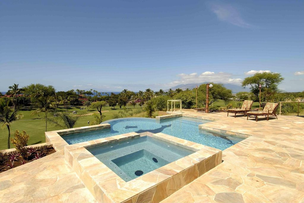 Modern Swimming Pool with exterior stone floors, Pool with hot tub