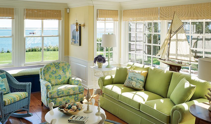 Cottage Living Room with Crown molding, double-hung window, picture window, Standard height, Hardwood floors, Wall sconce