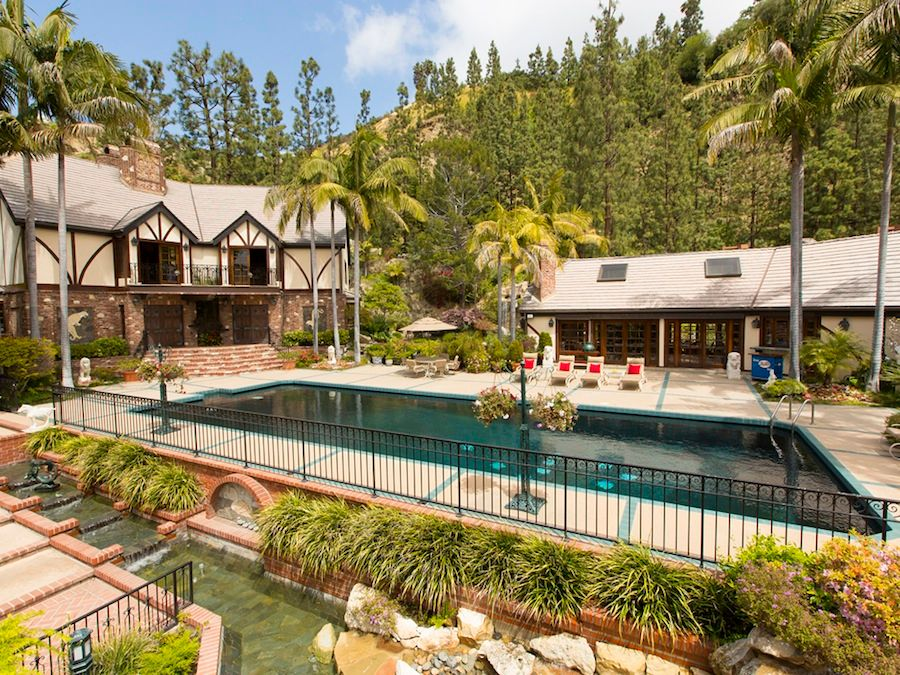Traditional Swimming Pool with Pathway, picture window, exterior stone floors, Pond, Deck Railing, Fence, Lap pool