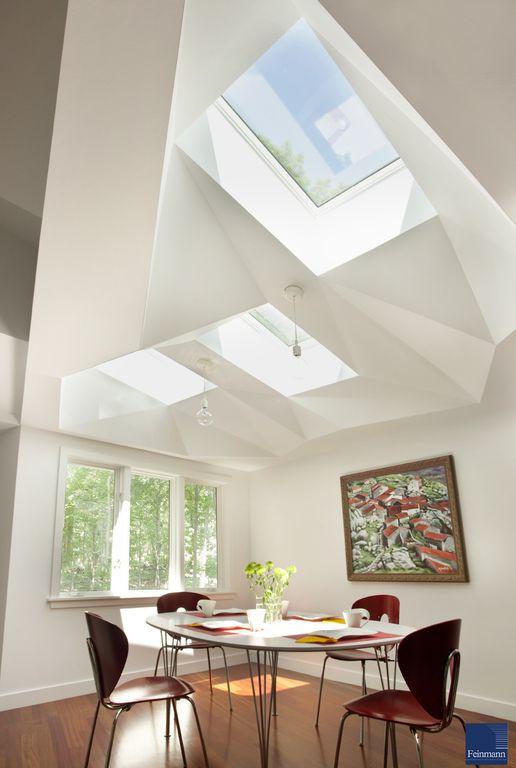 Contemporary Dining Room with Hardwood floors, Casement, Pendant light, High ceiling, Skylight