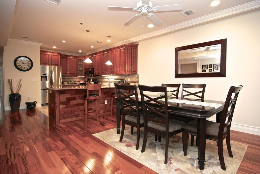 Traditional Dining Room with Standard height, Hardwood floors, Ceiling fan, Crown molding, can lights
