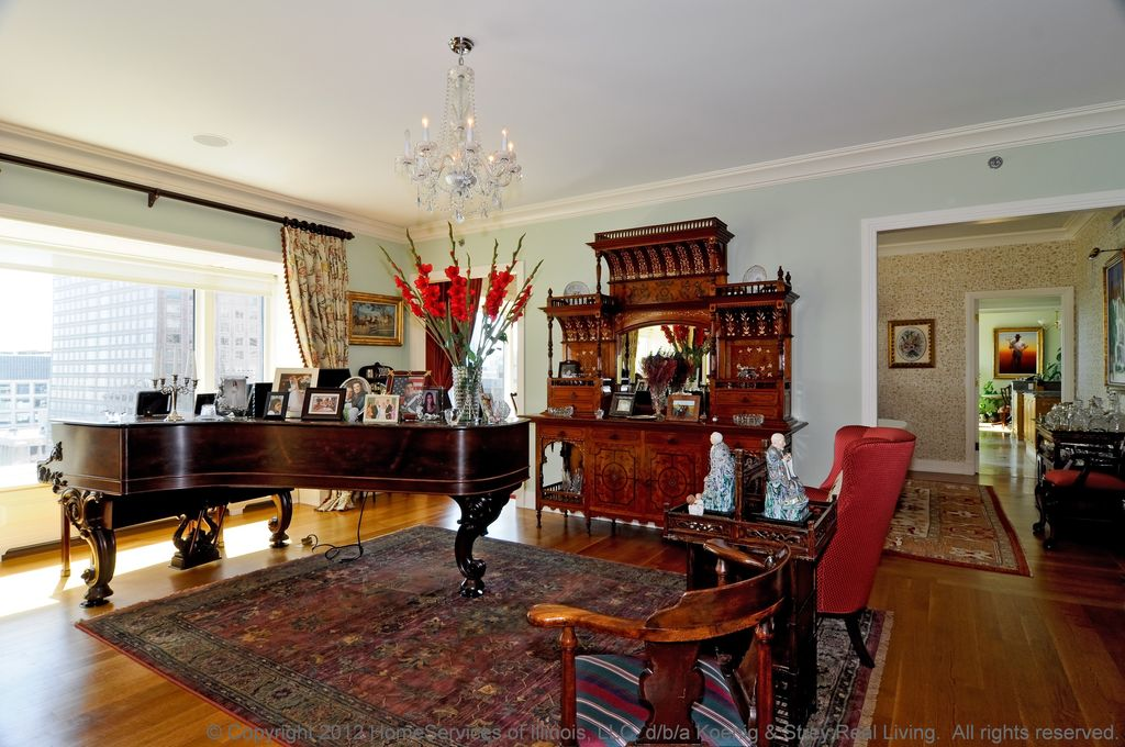Traditional Living Room with Crown molding, Chandelier, picture window, Hardwood floors, Standard height
