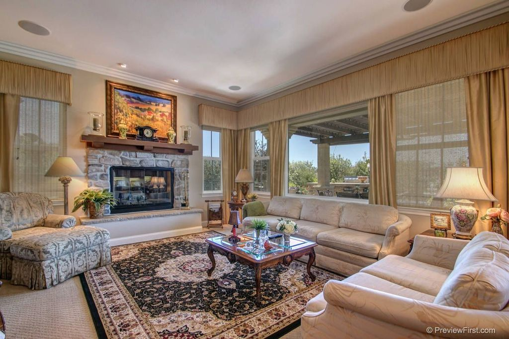 Traditional Living Room with double-hung window, Standard height, stone fireplace, Fireplace, picture window, can lights