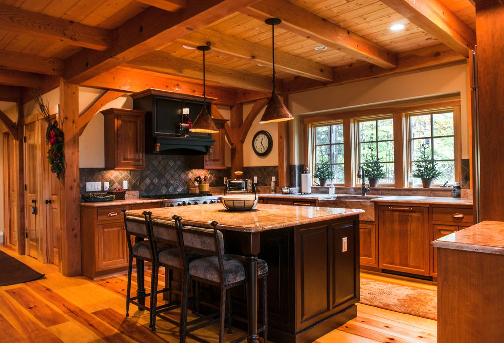 Country Kitchen with Pendant light, Copper cone pendant light, Exposed beam, can lights, Farmhouse sink, gas range, Casement
