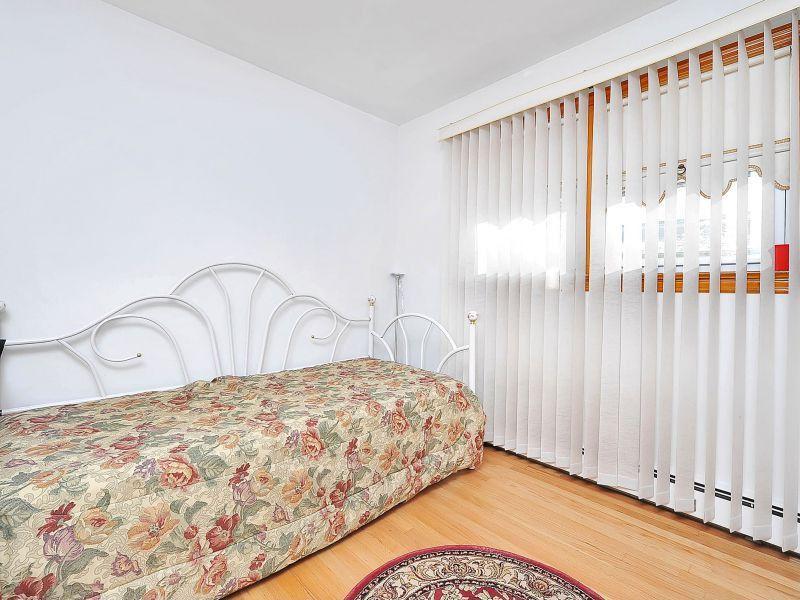 Craftsman Guest Bedroom with Standard height, Hardwood floors