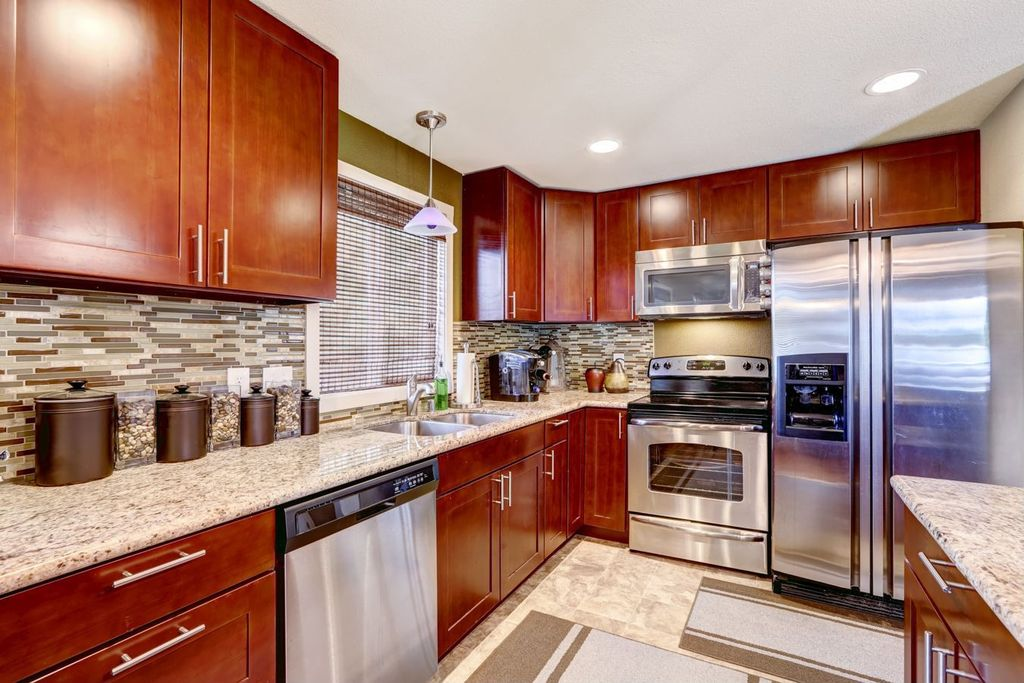 Contemporary Kitchen with Complex granite counters, L-shaped, Flat panel cabinets, Multiple Sinks, European Cabinets, Flush