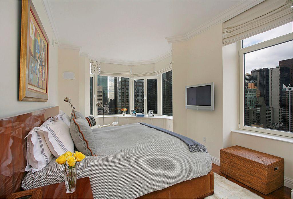 Contemporary Master Bedroom with Crown molding, Hardwood floors, Standard height, Casement, picture window