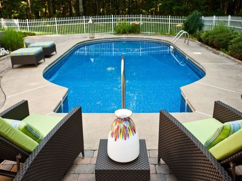 Contemporary Swimming Pool with Other Pool Type, Fence, exterior concrete tile floors, exterior tile floors