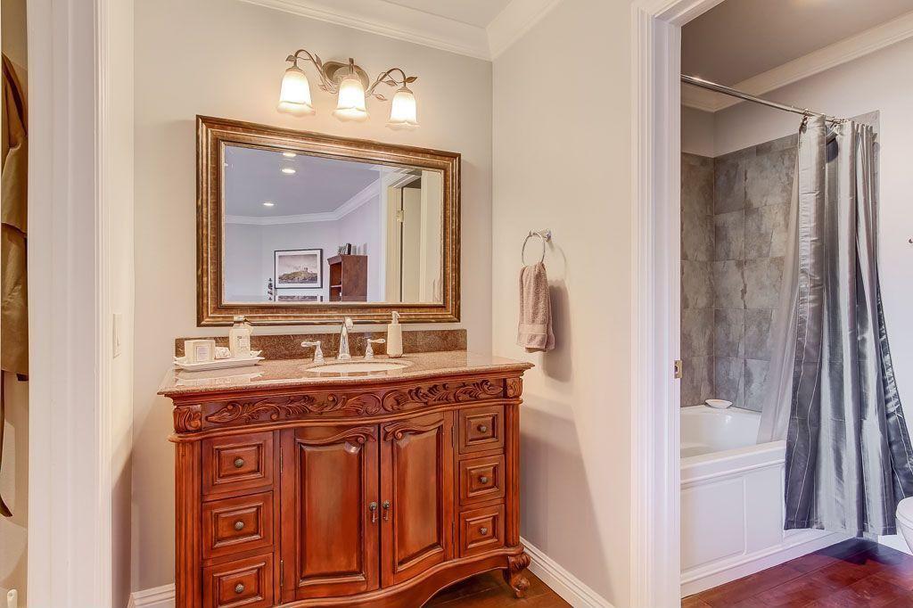"Traditional Full Bathroom with Arizona tile, MARIPOSA BUFF, Quartz, Feiss 18"" wide pewter 3-light bath fixture, Raised panel"