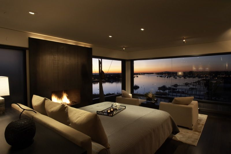 Contemporary Master Bedroom with flush light, Bedroom fireplace, Neutral color scheme, can lights, Harbor view, Fireplace