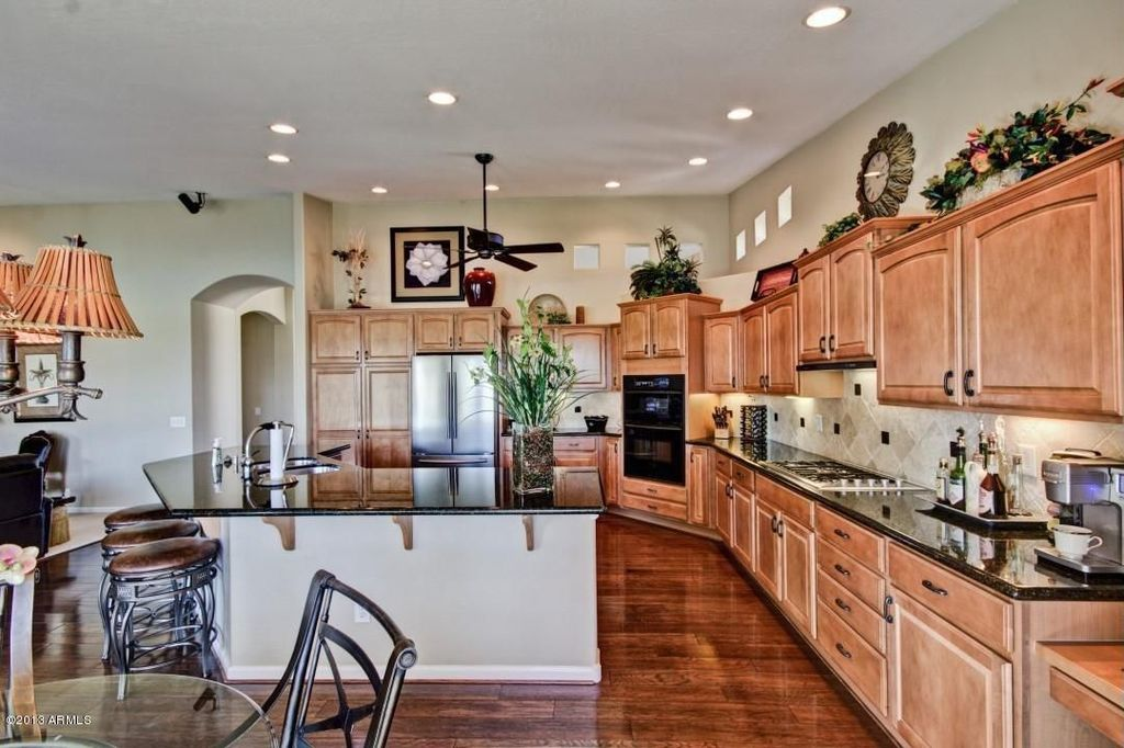 Traditional Kitchen with Raised panel, full backsplash, electric cooktop, Stone Tile, Undermount sink, Inset cabinets
