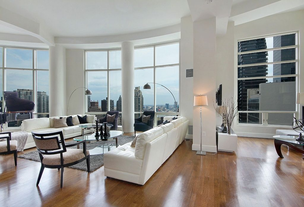 Contemporary Living Room with Hardwood floors, specialty window, High ceiling, Exposed beam, Columns, picture window