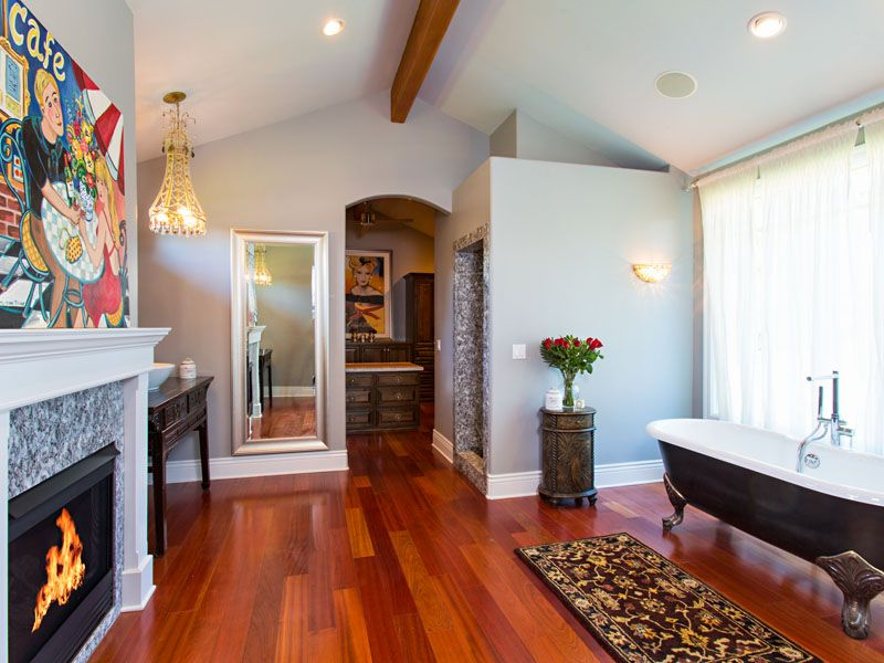 Eclectic Master Bathroom with Exposed beam, Master bathroom, Mohawk brazilian cherry hardwood flooring, Clawfoot, Wall sconce