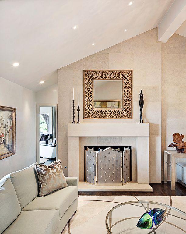 Contemporary Living Room with Arteriors home landry fireplace screen, Neutral area rug, Framed artwork, Sofa, Hardwood floors