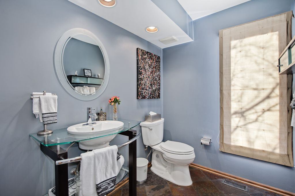 Contemporary Powder Room with Glass counters, Decor wonderland isabella frameless wall mirror, Powder room, stone tile floors