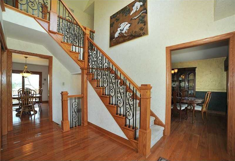 Craftsman Staircase with High ceiling, curved staircase, Carpet