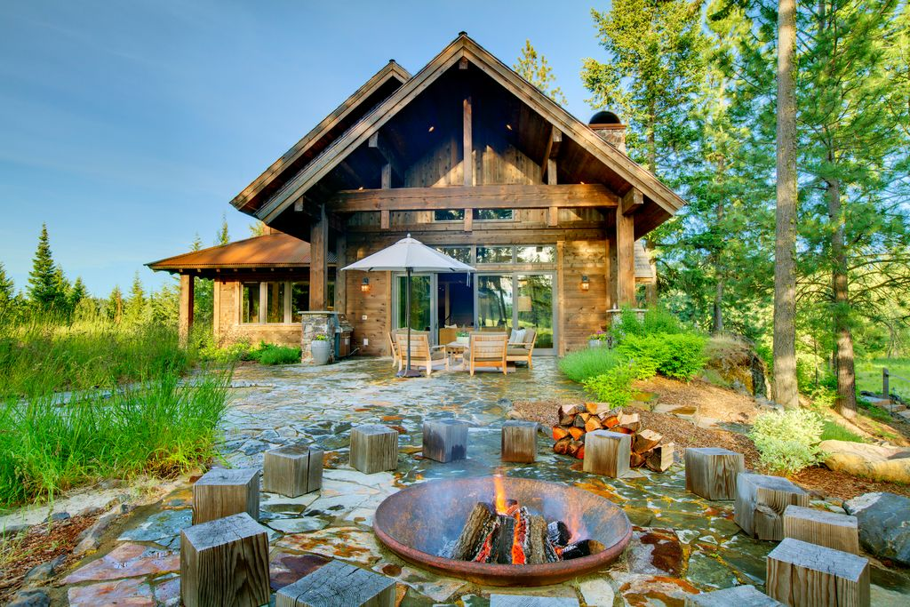 Rustic Patio with French doors, picture window, Fire pit, exterior stone floors