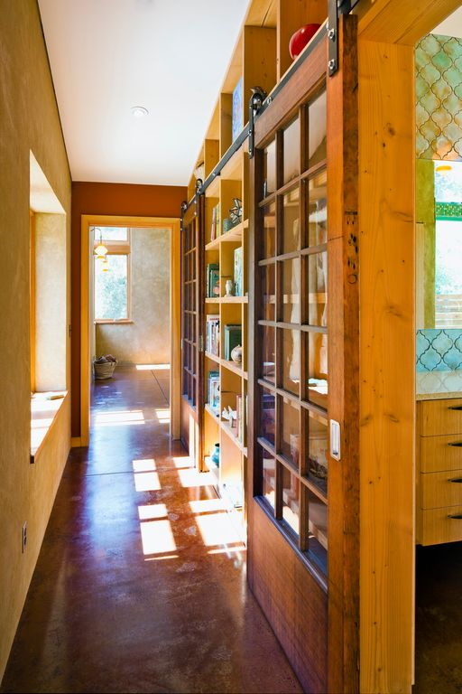 Eclectic Hallway with Casement, can lights, Concrete floors, Built-in bookshelf, Standard height