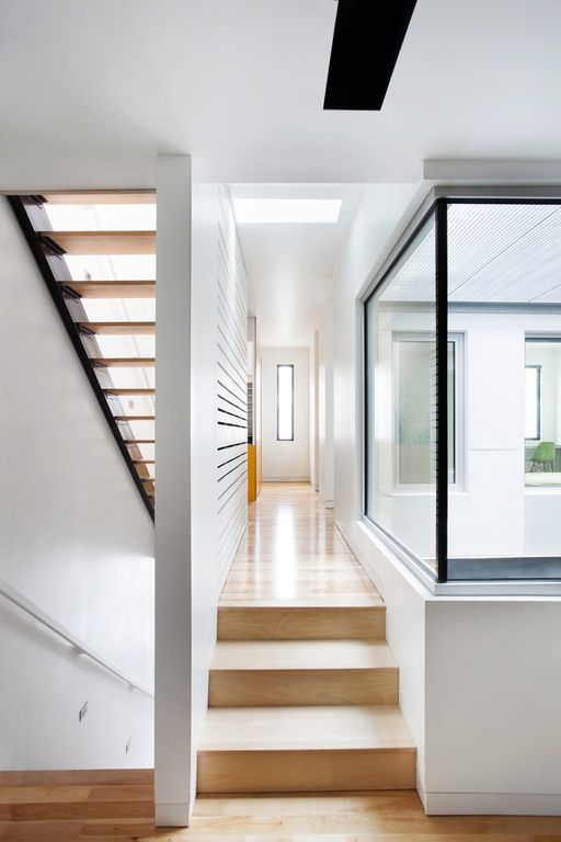 Contemporary Hallway with Skylight, Hardwood floors